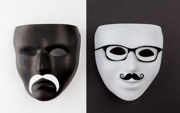 Black sad and white happy masks Stock Image