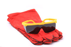 Black safety glasses with red leather gloves Stock Photos