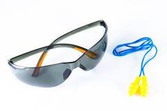 Black safety goggle and earplug. Stock Photo