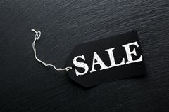 Black Sale tag background. Black Sale tag on slate background Royalty Free Stock Photography