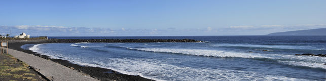 Black sand beach Stock Images