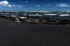 Black sand beach at Bali island in Indonesia Stock Image