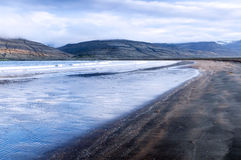 Black sand beach and blue sea, Iceland Royalty Free Stock Photography