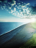 The black sand beach from the cliff of Dyrholaeyjarviti Stock Photo