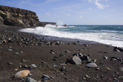 Black sand beach and cliffs, Fuerteventura Royalty Free Stock Photo