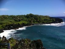 Black sand beach cliffside stock photos