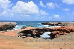 Black sand beach on the coast of Aruba. Black sand beach on the coast of the Three bridges Royalty Free Stock Image