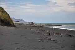 Black sand beach on the east coast of the South Island of New Zealand royalty free stock photo
