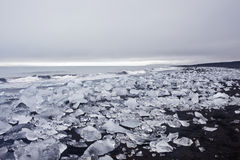 Black Sand Beach with Ice. Jokulsarlon ice lagoon in south eastern Iceland is right between Vatnajokull glacier and the ocean. The setting for lots of Hollywood Stock Images