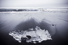 Black Sand Beach with Ice. Jokulsarlon ice lagoon in south eastern Iceland is right between Vatnajokull glacier and the ocean. The setting for lots of Hollywood Stock Photo
