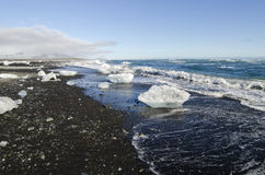 Black Sand Beach, Iceland. A landscape shot of the washed up ice at Black Sand Beach in Iceland Stock Image