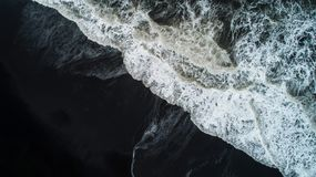 The black sand beach in Iceland. Sea aerial view and top view. A royalty free stock photo