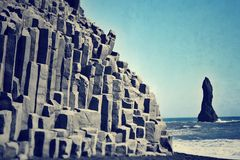 Black sand beach iceland. Stone columns in the black sand beach iceland Royalty Free Stock Photo