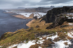 Black sand beach landscape in spring, Iceland. Black sand beach landscape in spring season, North Atlantic Ocean coast. Vik, Iceland Stock Images