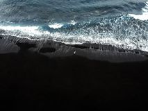 Black sand beach of Los Gigantes in Tenerife royalty free stock images