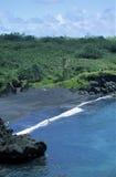 Black Sand Beach, Maui. A vertical view of the small, tropical Black Sand Beach in Waianapanapa State Park on the island of Maui, Hawaii Stock Photos