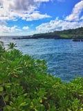 Black sand beach Ocean scene in maui hawaii Stock Photo