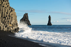 Black sand beach with ocean waves and Reynisdrangar rocks at winter, Iceland Stock Image
