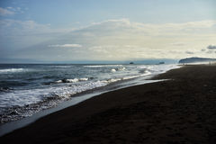 Black sand beach. Pacific ocean black sand beach, Kamchatka Royalty Free Stock Photo