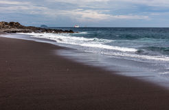 Black sand beach in Padangbai, Bali Island, Indonesia Stock Image