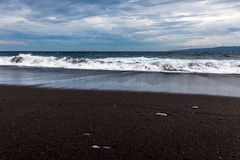 Black sand beach in Padangbai, Bali Island, Indonesia Stock Photos