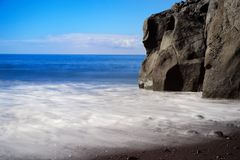 Black sand beach Praia Formosa on Portuguese island of Madeira. Rock formation on Praia Formosa beach - famous public black sand beach on Portuguese island of stock images