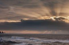 Black Sand Beach Reynisfjara in Iceland. Morning Sky and Ocean Waves. Morning Sunrise. Stock Photo
