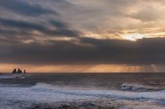 Black Sand Beach Reynisfjara in Iceland. Morning Sky and Ocean Waves. Rocks in Water. Sunrise. Stock Photography