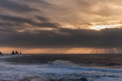 Black Sand Beach Reynisfjara in Iceland. Morning Sky and Ocean Waves. Windy Morning. Stock Photos