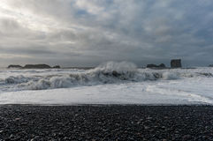 Black Sand Beach Reynisfjara in Iceland. Waves and Water Spray Stock Photos