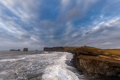 Black Sand Beach Reynisfjara in Iceland. Windy Morning. Ocean Waves, Blue Sky Stock Images