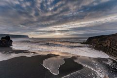 Black Sand Beach Reynisfjara in Iceland. Windy Morning. Ocean Waves. Cloudy Sky. Stock Images