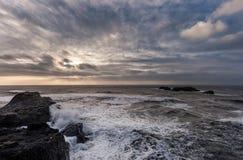 Black Sand Beach Reynisfjara in Iceland. Windy Morning. Ocean Waves, Rocks in Water. Royalty Free Stock Image