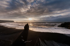 Black Sand Beach Reynisfjara in Iceland. Windy Morning. Ocean Waves and Sunrise Light. Royalty Free Stock Photography