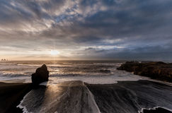 Black Sand Beach Reynisfjara in Iceland. Windy Morning. Ocean Waves. Wide Angle. Sunrise. Stock Images