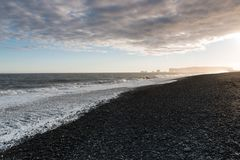 The black sand beach of Reynisfjara and the mount Reynisfjall royalty free stock photography
