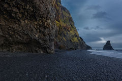 The black sand beach of Reynisfjara. And the mount Reynisfjall from the Dyrholaey promontory in the southern coast of Iceland royalty free stock photo