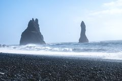 Black sand beach of Reynisfjara, Vik. The Black sand beach of Reynisfjara, Vik and the mount Reynisfjall from the Dyrholaey promontory and Volcanic rock in the stock image