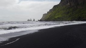 The black sand beach of Reynisfjara in the southern coast of Vik, Iceland.