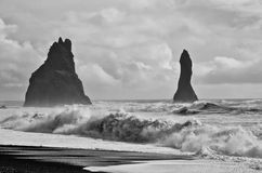 Black Sand Beach with Rogue Wave. The Reynisfjara shore near Vik, Iceland is known for its black sand beach, standing rock formation, and powerful waves from the Stock Photography