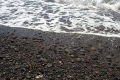 Black sand beach. Nothern Bali. Black sand beach with sea wave. Nothern Bali background royalty free stock photography