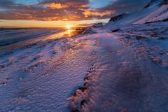 Black sand beach at Stokksnes during sunset, Iceland royalty free stock photography