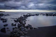 Black sand beach. At sunset, Big Island, Hawaii Stock Photos