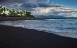 Black Sand Beach Tropical island Stock Photography