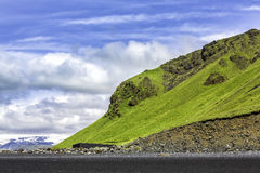 The black sand beach with typical Icelandic mountain Royalty Free Stock Images