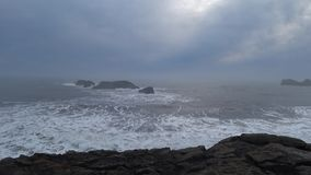 Powerful waves at black sand beach in Iceland 4k stock video footage