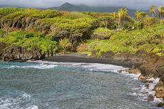 Black sand beach views in Waianapanapa State park Royalty Free Stock Image