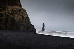Landscape around black sand beach in Vik, Iceland. Black sand beach in Vik is one of the most beautiful beaches on Earth Stock Photo