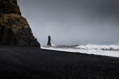 Landscape around black sand beach in Vik, Iceland. Black sand beach in Vik is one of the most beautiful beaches on Earth Royalty Free Stock Image