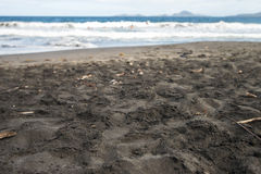 Black sand beach. Volcanic sand beach at Caribbean island Stock Photo